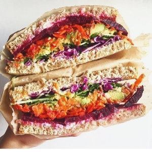 Who says a sandwich can't be healthy? LOVE this creation from @plantbasedblonde with beet, carrot, Dijon mustard, pea sprouts, red cabbage and veganaise - yum. #supersandwich #plantbased #instahealth #peasprouts #redcabbage #vegan #dairyfree